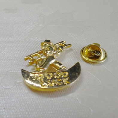 Die struck metal lapel pins
